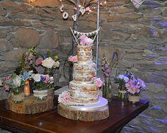 Naked wedding Cake with fresh flowers, Three tier, Bunting, Pink, Wedding cake http://www.jaimecakeskendal.co.uk