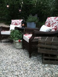 like the pea gravel...  This blog features an outdoor area furnished entirely by KMart