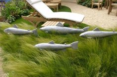 Loving this shoal of gorgeous fish, so touchable and the stipa grass that they are swimming through looks just like waves..For more seaside inspiration in the garden here is a link... https://uk.pinterest.com/growveg/seaside-gardens/