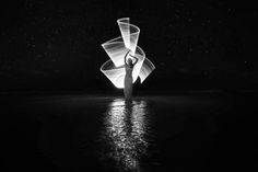 The black and white dreams collection. Is this a thing? Colors have gone away but we can still see through the night.  Lit by hand in one second. with http://instagram.com/kimhenry.dance  Light-painting explained in http://fb.com/groups/ericpare