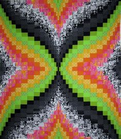 Are you looking for an idea to give your next quilt project a burst of energy? Try these tips for combining black and white fabrics with a few brights to add a pop of color and excitement to your quilt pattern.