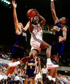 Dominique Wilkins drives on Dikembe Mutombo