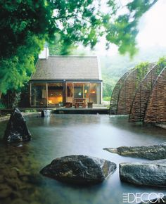 In Johan Dieden's Swedish house, designed by architects Gert and Karin Wingårdh, woven-willow arches lead to the glass-wall structure, set above a reflecting pool.