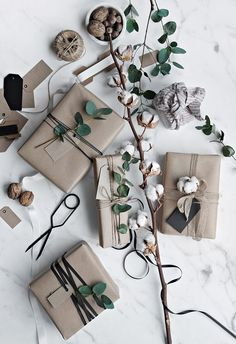 Get in the holiday spirit! As you're buying gifts, add a personal touch with Unique 50 Christmas gift wrapping ideas! Upcycled Kraft Paper Gift Wrapping Ideas From: The Found and The Fancy How to P… Decoration Christmas, Noel Christmas, Christmas Gift Wrapping, Christmas Presents, Holiday Gifts, Christmas Crafts, Christmas Paper, Christmas Holidays, Christmas Ideas
