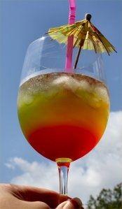 Malibu Reggae Rainbow    (2 oz Malibu  coconut rum  1 oz Midori melon liqueur  3 - 4 oz pineapple juice  1 splash cranberry juice)
