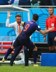 Manchester United duo Louis van Gaal and Robin van Persie celebrating against Spain in the  2014 World Cup