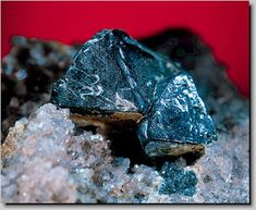 Gahnite.Colour:Dark blue-green, yellow, brown, black. Streak:Grey. Hardness (Mohs):7½ - 8.Type Locality:Falun mine, Falun, Dalarna, Sweden.
