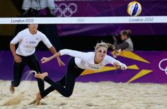 Kerri Walsh Jennings dives for a shot during the women's beach volleyball preliminary match between the U.S. and Czech Republic.