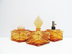 Three 1930s Art Deco Perfume bottle and vanity set, amber honey gold pressed glass, czechoslovakia Czeck powder box Height 6.2 in / 16.7 cm by EbyVintage on Etsy