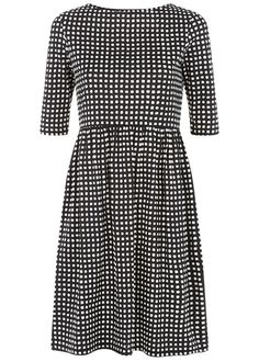Black check jersey dress in certified 100% organic cotton. Elbow length jersey dress with gathered waist, falls just above the knee. Also available in bordeaux. Length 96cm.