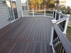Deck color, white columns, black rails. Like that. Matches the casa