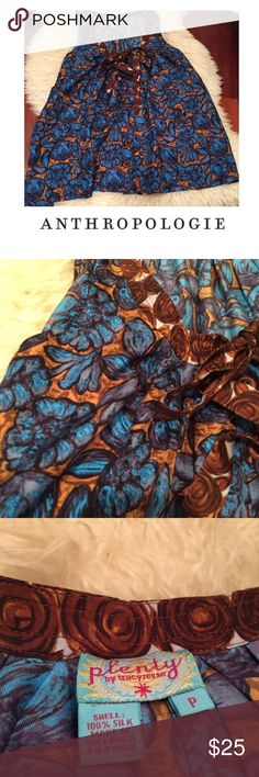 Anthropologie Plenty Tracy Reese Blue Floral Top Anthropologie Plenty Tracy Reese Blue Floral Top. 18 inch bust. 26 inches long. Wooden button. Tie in front. Silk. Size p which is small, but runs large should be a looser fit. Excellent condition. Feel free to make an offer or bundle and save. Anthropologie Tops Blouses