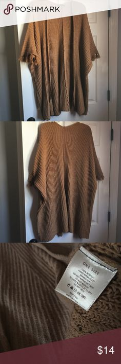 Open front Poncho-One Size Knit open front Poncho with fringe at arm opening. Color is tan. In great condition, very minor snagging due to material which is barely noticeable at all when wearing. Sweaters Shrugs & Ponchos