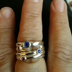 Multi band look ring New, silver plated ring, size 8, with blue and purple stones. Ring has the look of 4 bands intertwined together. Will bundle. Jewelry Rings