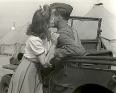 Girl kissing soldier. World War 2 .Jeeps, chick magnets since 1941.
