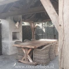 Concrete, Weathered Oakwood & Black Metal Doors