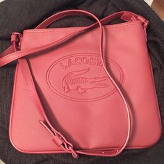 38f7c791dc6152 NWOT Lacoste cross-body bag Brand new Lacoste cross-boy bag in maroon.