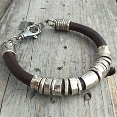 Sterling Silver Leather Bracelet Handmade Sterling Silver Bracelet Wild Prairie Silver Jewelry By Joy Kruse Handmade Sterling Silver Leather Bracelet With Spinning Sterling Rings Rustic Natural Beauty... Heavy Sterling Swivel Clasp & Extension Links For The Perfect Fit. Available with Hammered Only Spinning Rings or Hammered & Ball Detailed Spinning Rings ~ Alittle more decorative... (Men usually pick the hammered only rings) You Can Make This Selection At Checkout Hammered Only or B...