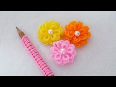 Hand Embroidery Amazing Trick - Easy Woolen Flower Making Ideas with Pencil - DIY Wool Flower Design - YouTube Yarn Flowers, Knitted Flowers, Burlap Flowers, Crochet Flower Patterns, Hand Embroidery Flowers, Hand Embroidery Tutorial, Woolen Flower, Woolen Craft, Mehndi Designs Book