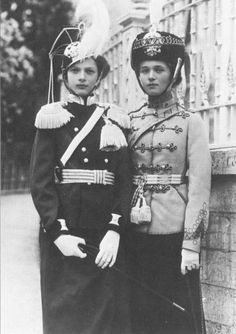Olga and Tatiana Romanov.    Around 1913.    Such a charming photograph.