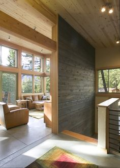 Landing, with exterior stained wood accent and pine paneling. Wintergreen Cabin, by Balance Associates Architects. Methow Valley, Washington. #paneling