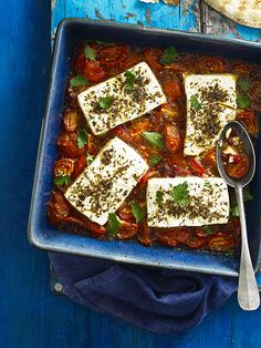 Baked feta with pomegranate and tomatoes