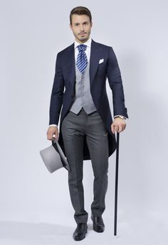 I like the blue jacket and interesting tie with pin. The pants are a little too slim fit but close.