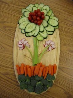 Lovely flower with cucumber, celery, tomatoes, carrots, and broccoli...delicious!!!