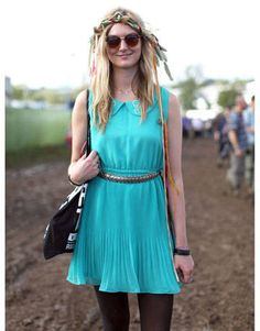 Major props for donning a bright blue church dress to these muddy grounds. Her mixed media headpiece is a fun bohemian touch.   - HarpersBAZAAR.com