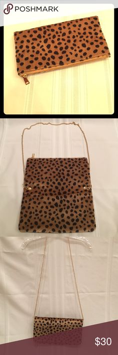 Leopard Print Clutch and Handbag NWOT Leopard print clutch with detachable chain for multi purpose wear. Zippered top closure, lots of inside room. Zippered pocket inside. Detachable chain strap measures 50 inches. Clutch is 13 L by 12 W when expanded. When folded it is 6 1/2 by 12. Price is solid since this is new and never used. Brand is generic- purchased from boutique. Bags Clutches & Wristlets