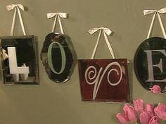 Mirrors of different shapes and sizes can be made into a unique wall hanging. Create stencils on a home computer using a variety of fonts. Cut out the letters and spray the back of the paper with spray mount; allow paper to dry until tacky. Adhere the stencil to the mirror then cover with spray paint.