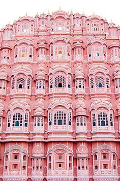Pink Palace, Jaipur, India.......makes you feel like your in a fantasy world ,where every thing and everyone has gone stark crazy...the sheer amount of pink in this is startling and just proves India to be such a colorful place.