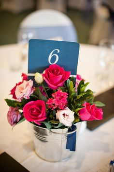 Easy DIY centerpiece. love the simple table numbers.