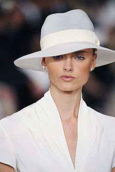 simple, clean - elegant marriage of a fedora and wide brim shape. this is really well done, and would wear easily