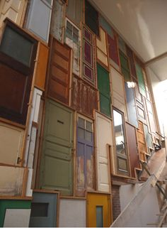 LOVE this wall of doors. I don't know if I'll ever have the space to do this, but I love it still...