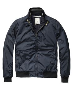This is an example of a bomber jacket because it is a short jacket with a collar, side pockets, cuffs, and a waistband.