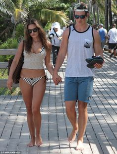 Where she goes, he goes too: The 28-year-old accompanied his beloved with a tight grip...