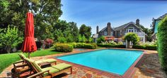 Sparkling pool and spa are surrounded by stretches of beautiful lawn in California