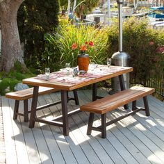 Add a perfect focal point to your outdoor space with this rustic Acacia wooden set. The Carlisle table and benches are each complete with an iron frame that accentuates the sandblasted finish to offer a raw yet refined edge to any arrangement.