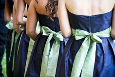 Color blocked bridesmaid dresses - Navy blue silk with green sash tied in a bow.