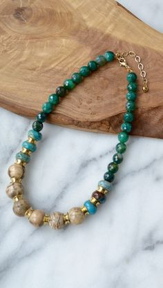 "All semi precious stones including green agate, jasper and feldspathgraphic 17"" long with 3"" extender Made in New York *Please note: Due to the one-of-a-kind nature of the semi precious stones used, e"