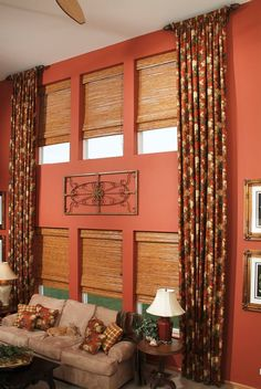 Stationary Gathered Side Panels on Wood Pole with Woven Wood Roman Shades with Custom Accent Pillows