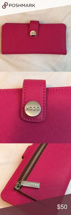 Hobo Hot Pink Button Wallet! Hobo button wallet, very good used condition, one small stain other than that it's in excellent condition! No tears or rips! Zipper runs and button snaps! No trades, No low balls! Happy Poshing! HOBO Bags Wallets