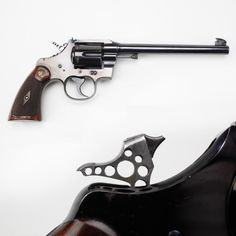 """A.P. Lane's Olympic Revolver - This Colt revolver, factory-fitted with a skeletonized hammer, was used by A. P. Lane. Known as the """"Pistol Wizard,"""" Lane used this Colt to win five Olympic Gold Medals – three in 1912 & two in 1920. When an Olympian wins a medal, they also get a certificate that goes along with the medal. We're lucky to have his revolver, his five medals & the five certificates that go along with them! NRA National Firearms Museum in Fairfax, VA. http://goo.gl/WrDQFm"""