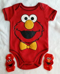 A size 1-3 mo old Elmo Onsie Set with matching barefoot sandals  Would be great for a Baby Shower gift.