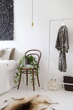 Bedroom inspiration for Gyprock's Tempo cornice. Love the plant on bedside chair and pipe clothes rack.