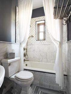 contemporary white & gray bathroom with two extra long shower curtains hung close to the ceiling making the bathroom look HUGE!... Beautiful Bathroom Inspiration: Contemporary Shower Curtain Ideas from Bathroom Bliss by Rotator Rod