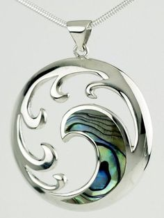 Large sterling silver koru pendant featuring paua shell inlay and presented on 18 inch sterling silver snake chain. Koru means coiled, looped or folded in Moari and the design is inspired by an unfurling fern frond as it opens bringing new life and purity to the world.