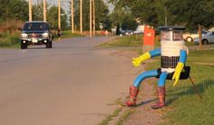 If you happen to see a robot on the side of the road this summer, don't be afraid to pick him up. That's just hitchBOT, a friendly hitch-hiking robot trying to make his (her? its?) way from Boston to San Francisco.