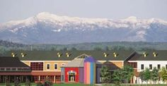 Vermont Teddy Bear Factory with mountains in Shelburne, VT